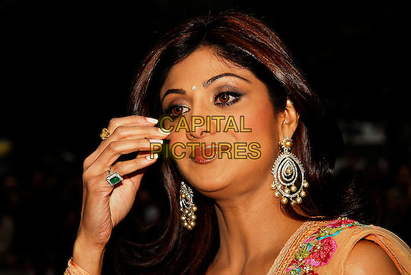 """SHILPA SHETTY.""""Life In A ... METRO"""" world premiere at the Empire Leicester Square, London, England..May 8th, 2007.headshot portrait dangling diamond pearl earrings bindi hand ring jewellery jewelry .CAP/IA.©Ian Allis/Capital Pictures"""
