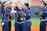 11 February 2012:  FIU's players (pictured, from left to right, Jessy Alfonso (8), Kayla Burri (7), Brie Rojas (24), Mariah Dawson (23), and Rachel Slowik (17)) high-five as the University of Massachusetts Minutewomen defeated the FIU Golden Panthers, 3-1, as part of the COMBAT Classic Tournament at the FIU Softball Complex in Miami, Florida.