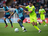 Sam Wood of Wycombe Wanderers and Drey Wright of Colchester United during the Sky Bet League 2 match between Wycombe Wanderers and Colchester United at Adams Park, High Wycombe, England on 27 August 2016. Photo by Liam McAvoy.