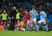 9th January 2018, Etihad Stadium, Manchester, England; Carabao Cup football, semi-final, 1st leg, Manchester City versus Bristol City; Jamie Paterson of Bristol City is challenged by John Stones of Manchester City
