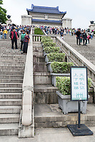 "Nanjing, Jiangsu, China.  Looking up Steps toward the Sun Yat-sen Mausoleum.  ""Please be respectful of others"" on the Sign."