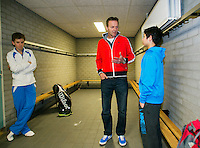 Rotterdam, The Netherlands, 15.03.2014. NOJK 14 and 18 years ,National Indoor Juniors Championships of 2014, Player coach evaluation in the dressing room with coach Tjerk Bogtstra and his pupil Sidané Pontjodikromo, left Alec Deckers<br /> Photo:Tennisimages/Henk Koster