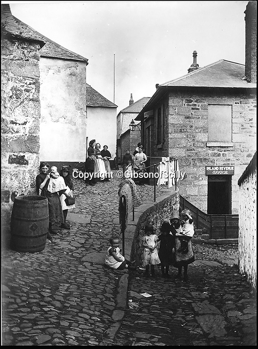BNPS.co.uk (01202 558833)<br /> Pic: GibsonOfScilly/BNPS<br /> <br /> Poor kids in Penzance around 1900.<br /> <br /> An archive of eye-opening photographs documenting the grim reality of Poldark's Cornwall has emerged for sale for &pound;25,000.<br /> <br /> More than 1,500 black and white images show the gritty lives lived by poverty-stricken families in late 19th and early 20th century Cornwall - around the same time that Winston Graham's famous Poldark novels were set.<br /> <br /> The collection reveals the lowly beginnings of towns like Rock, Fowey, Newquay and St Ives long before they became picture-postcard tourist hotspots.<br /> <br /> Images show young filth-covered children playing barefoot in squalid streets, impoverished families standing around outside the local tax office, and weather-beaten fishwives tending to the day's catch.<br /> <br /> The Cornish archive, comprising 1,200 original photographic prints and 300 glass negative plates, is tipped to fetch &pound;25,000 when it goes under the hammer as one lot at Penzance Auction House.