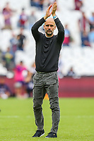 Pep Guardiola (Manager) of Manchester City applauds the travelling fans after the Premier League match between West Ham United and Manchester City at the London Stadium, London, England on 10 August 2019. Photo by David Horn.