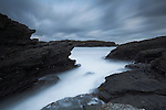 Stormy sky with dramatic rugged coast at Porth-y-Post, Anglesey, North Wales, UK