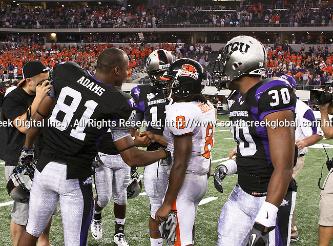 TCU Horned Frogs wide receiver Alonzo Adams #81 and Oregon State Beavers wide receiver James Rodgers #8 talking after the game between Oregon State Beavers and TCU Horned Frogs at the Cowboy Stadium in Arlington,Texas. TCU defeated Oregon State 30-21.