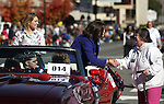 An unidenitified supporter greets Rep. Shelley Berkley, D-Nev., during the Nevada Day parade in Carson City, Nev. on Saturday, Oct. 27, 2012. State Treasurer Kate Marshall is at left..Photo by Cathleen Allison