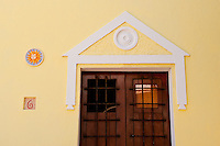 Wooden doors on bright yellow building in Old San Juan.