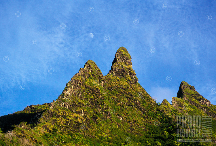Moonrise over Makana ( Bali hai) peak, from the Na Pali coastline trail on Kauai's famous north shore