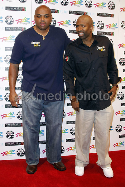 "2 July 2008 - Las Vegas, Nevada - Charles Barkley and Kenny Smith. Annie Duke and Don Cheadle host the 2nd Annual ""Ante Up For Africa"" Celebrity Poker Tournament during the 2008 World Series of Poker held at the Rio All-Suite Hotel and Casino. Photo Credit: MJT/AdMedia"