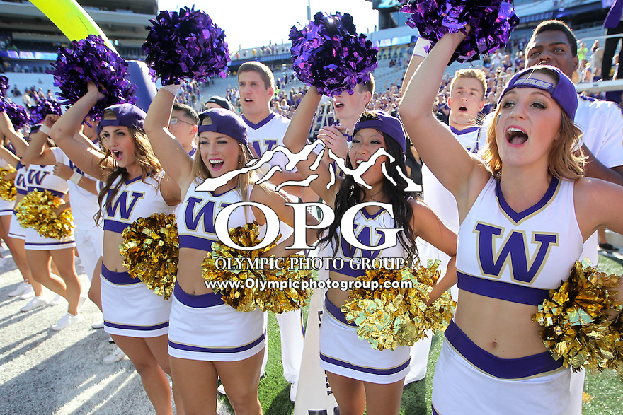 Sept 13, 2014: Washington cheerleaders celebrated with the football team after the game by singing the school fight song to fans.  Washington defeated Illinois 44-19 at Husky Stadium in Seattle, WA.