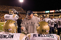 "Pitt defensive line coach Greg Gattuso gives instructions to Rashaad Duncan and Ernest ""Mick"" Williams. The Pitt Panthers upset the West Virginia Mountaineers 13-9 on December 01, 2007 in the 100th edition of the Backyard Brawl at Mountaineer Field, Morgantown, West Virginia."