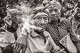 INDONESIA, Flores, 100 year old elder Wilhelmus Etu has a smoke with his friends, in Kampung Tutubhada village in Rendu