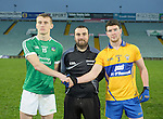 Captains Eoin Ryan of Limerick and Darragh Nagle of Clare with referee Donnacha O Callaghan during the Mc Nulty Cup U-21 final at The Gaelic Grounds. Photograph by John Kelly.