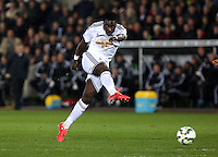 SWANSEA, WALES - MARCH 16: Bafetimbi Gomis of Swansea takes a shot off target during the Premier League match between Swansea City and Liverpool at the Liberty Stadium on March 16, 2015 in Swansea, Wales