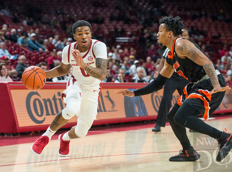 NWA Democrat-Gazette/BEN GOFF @NWABENGOFF <br /> Desi Sills of Arkansas dribbles past Donovan Donaldson of Tusculum in the first half Friday, Oct. 26, 2018, during an exhibition game in Bud Walton Arena in Fayetteville.