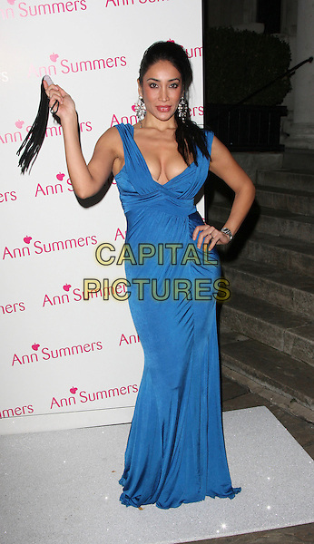 "SOFIA HAYAT .Ann Summers Party to launch new 2009 ""Enchantment"" collection and unveil Lois Winstone as the new 'Face Of Ann Summers' at One, Marylebone, London - December 1st 2008..full length sophia long blue maxi dress cleavage hand on hip holding whip tasslels .CAP/ROS.©Steve Ross/Capital Pictures"