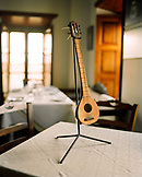 GREECE, Patmos, Skala, Dodecanese Island, a small instrument is displayed on a table at Taverna Tzivaeri