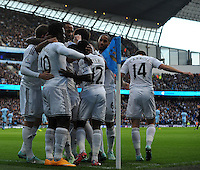 Picture: Andrew Roe/AHPIX LTD, Football, Barclays Premier League, Manchester City v Swansea City, 22/11/14, Etihad Stadium, K.O 3pm<br /> <br /> Swansea's players celebrate Wilfred Bpny's opener<br /> <br /> Andrew Roe>>>>>>>07826527594