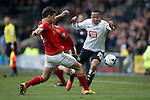 Forest's Eric Lichaj tackles Marcus Olsson of Derby during the Skybet Championship match at the iPro Stadium. Photo credit should read: Philip Oldham/Sportimage