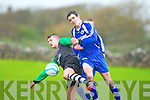 Fenit Samphires John Maher and Abbeyfeale's Mike Kelliher in action in the FAI Junior cup at Fenit on Saturday.