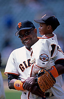 SAN FRANCISCO, CA - Manager Dusty Baker of the San Francisco Giants holds his son Darren Baker during family day before a game at Pacific Bell Park in San Francisco, California on July 14, 2002. (Photo by Brad Mangin)
