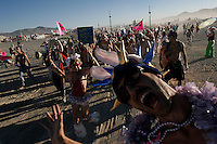 BLACK ROCK CITY,NV - AUGUST 28,2008:  The million Bunny march walks the main Playa of  Burning Man Event, August 28,2008.