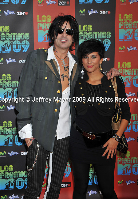 UNIVERSAL CITY, CA. - October 15: Tommy Lee and guest attend Los Premios MTV 2009 Latin America Awards held at the Gibson Amphitheatre on October 15, 2009 in Universal City, California.
