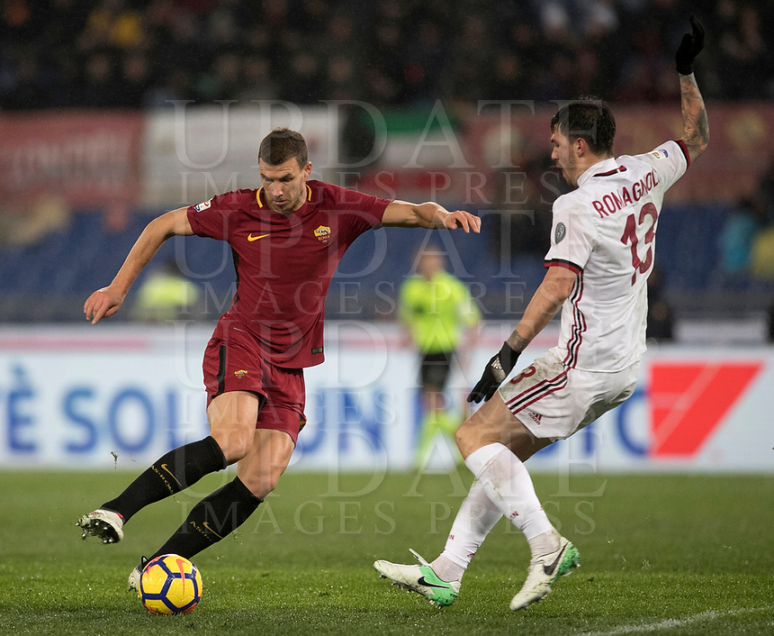 Calcio, Serie A: AS Roma - AC Milan, Roma, stadio Olimpico, 25 febbraio, 2018.<br /> Roma's Edin Dzeko (l) in action with Milan's Alessio Romagnoli (r) during the Italian Serie A football match between AS Roma and AC Milan at Rome's Olympic stadium, February 28, 2018.<br /> UPDATE IMAGES PRESS/Isabella Bonotto