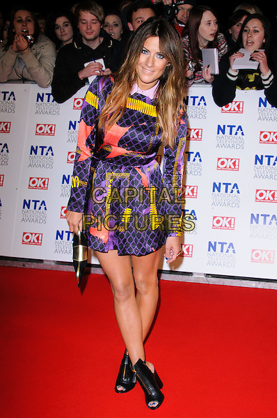 Caroline Flack.arrivals at The National Television Awards, O2 Greenwich, London, England. 25th January 2012.NTA NTAS full length dress purple pink yellow print pattern black ankle boots open toe clutch bag.CAP/CJ.©Chris Joseph/Capital Pictures.