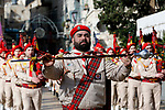 Scouts parade as the Greek Orthodox Patriarch of Jerusalem Theophilos III arrives to celebrate Christmas according to the Eastern Orthodox calendar, outside the Church of the Nativity in the West Bank town of Bethlehem on January 6, 2018. The municipalities of Bethlehem, Beit Sahour and Beit Jala, all in the Israeli-occupied West Bank, called for the boycott over Jerusalem's Greek Orthodox patriarch allegedly allowing controversial real estate sales. Photo by Wisam Hashlamoun