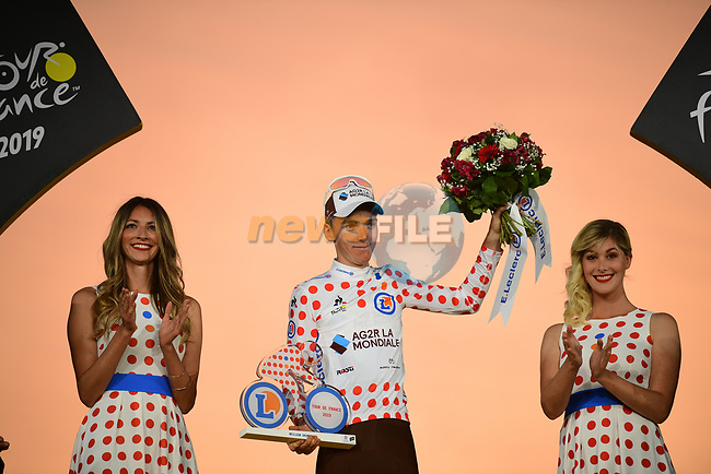 Romain Bardet (FRA) AG2R La Mondiale wins the mountains Polka Dot Jersey on the final podium at the end of Stage 21 of the 2019 Tour de France running 128km from Rambouillet to Paris Champs-Elysees, France. 28th July 2019.<br /> Picture: ASO/Pauline Ballet | Cyclefile<br /> All photos usage must carry mandatory copyright credit (© Cyclefile | ASO/Pauline Ballet)