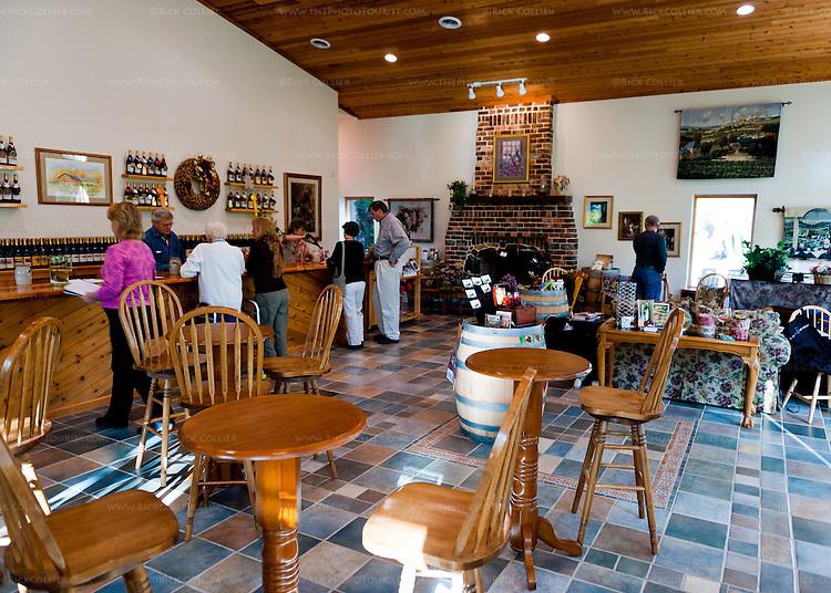 Visitors line the bar in the tasting room at Abingdon Vineyard and Winery, near Abingdon Virginia.