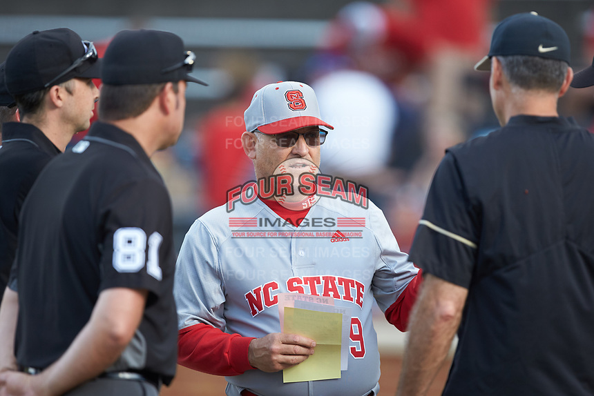 North Carolina State Wolfpack head coach Elliott Avent (9) meets with Wake Forest Demon Deacons head coach Tom Walter (16) prior to their ACC baseball game at David F. Couch Ballpark on April 18, 2019 in  Winston-Salem, North Carolina. The Demon Deacons defeated the Wolfpack 7-3. (Brian Westerholt/Four Seam Images)