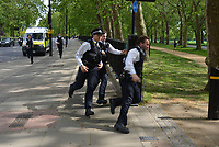 A man is arrested during a mass gathering protest organised by the group called 'UK Freedom Movement', in Hyde Park in London as the country is in lockdown to help stop the spread of coronavirus. The group claims that the coronavirus lockdown is illegal.<br /> London, England, UK on Saturday, May 16, 2020.<br /> CAP/PL<br /> ©Phil Loftus/Capital Pictures