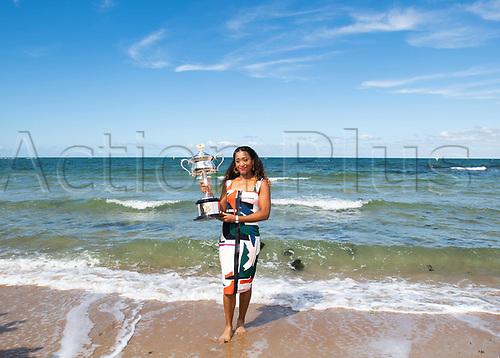 27th Januatu 2019, Melbourne, Australia; 2019 Australian Open Naomi Osaka of Japan on Melbourne Beach with her winners trophy