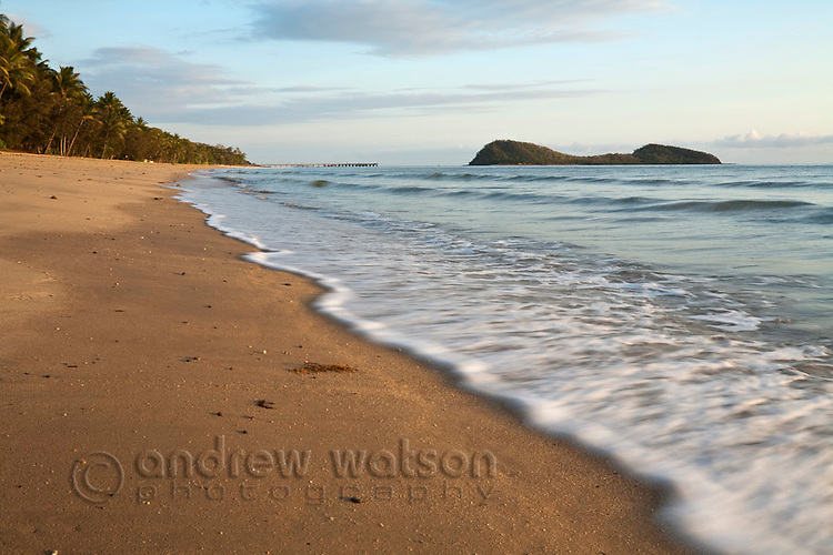 View along beach at Palm Cove with Double Island in background.  Palm Cove, Cairns, Queensland, Australia