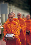 Buddhist monks gather donations in the morning in Chang Mai, Thailand.  What they gather each morning will sustain them through the day.