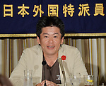 June 5, 2013, Tokyo, Japan - Takafumi Horie, founder of SNS Inc. and former president of Livedoor, speaks about his wishes to support the Japanese economy and people during a press conference at The Foreign Correspondents' Club of Japan, June 5, 2013. Horie was released from prison on March 28, after 21 moths of a 30 months sentence, he was guilty and incarcerated in 2011 for fabricating financial reports and spreading false information to investors. But he continues to assert his innocence. (Photo by Natsuki Sakai/AFLO)