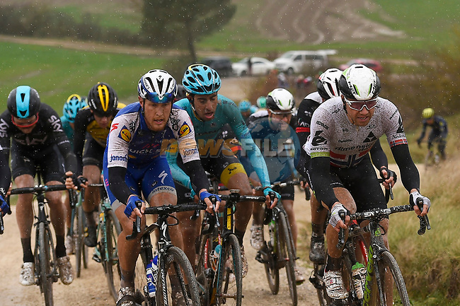 Matteo Trentin (ITA) Quick-Step Floors, Fabio Aru (ITA) Astana and Edvald Boasson Hagen (NOR) Dimension climb gravel sector 8 Monte Santa Maria during the 2017 Strade Bianche running 175km from Siena to Siena, Tuscany, Italy 4th March 2017.<br /> Picture: La Presse/Fabio Ferrari | Newsfile<br /> <br /> <br /> All photos usage must carry mandatory copyright credit (&copy; Newsfile | La Presse)
