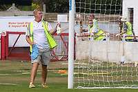 A Ramsgate steward disinfects the goalposts at half-time during Ramsgate vs Folkestone Invicta, Friendly Match Football at Southwood Stadium on 1st August 2020