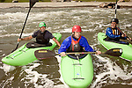 April 30, 2012. Charlotte, NC.. Erik Weihenmayer, center, regroups with Pablo McCandless, a former Olympic kayaker, left, and Rob Raker after going through a rapid.. Erik Weihenmayer, who has been completely blind since age 13, is training at the United States National White Water Center in an attempt to kayak through the Grand Canyon. Weihenmayer is an accomplished outdoorsman who has climbed the 7 Summits, and is the only blind person to climb Mount Everest.