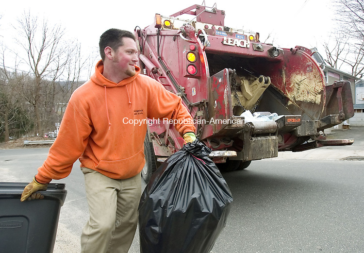 NAUGATUCK, CT. 03 April 2007-040307SV03--Matt Hurley collects trash in Naugatuck Tuesday. Naugatuck trash haulers have picked up about 200 more tons of garbage this year than they did the previous year. That's because all of the growth in the community is causing trash collections to go up. And the public works dept. is paying a ton in overtime costs to keep up with all the trash.<br /> Steven Valenti Republican-American