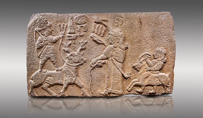 """Aslantepe Hittite relief sculpted orthostat stone panel. Limestone, Aslantepe, Malatya, 1200-700 B.C. Anatolian Civilisations Museum, Ankara, Turkey.<br /> <br /> Scene of king's offering drink and sacrifice to the god. The god is on the deer, with the bow attached to his shoulder and with a triple bundle of lightning in his hand. The king looks at the god, and makes the libation to the god while carrying a scepter with a curled end - lituus. Behind the king is a servant holding a goat for sacrifice to the god. Hieroglyphs read; """"God Parata, Strong King... """". <br /> <br /> Against a gray background."""