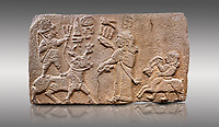 "Aslantepe Hittite relief sculpted orthostat stone panel. Limestone, Aslantepe, Malatya, 1200-700 B.C. Anatolian Civilisations Museum, Ankara, Turkey.<br /> <br /> Scene of king's offering drink and sacrifice to the god. The god is on the deer, with the bow attached to his shoulder and with a triple bundle of lightning in his hand. The king looks at the god, and makes the libation to the god while carrying a scepter with a curled end - lituus. Behind the king is a servant holding a goat for sacrifice to the god. Hieroglyphs read; ""God Parata, Strong King... "". <br /> <br /> Against a gray background."