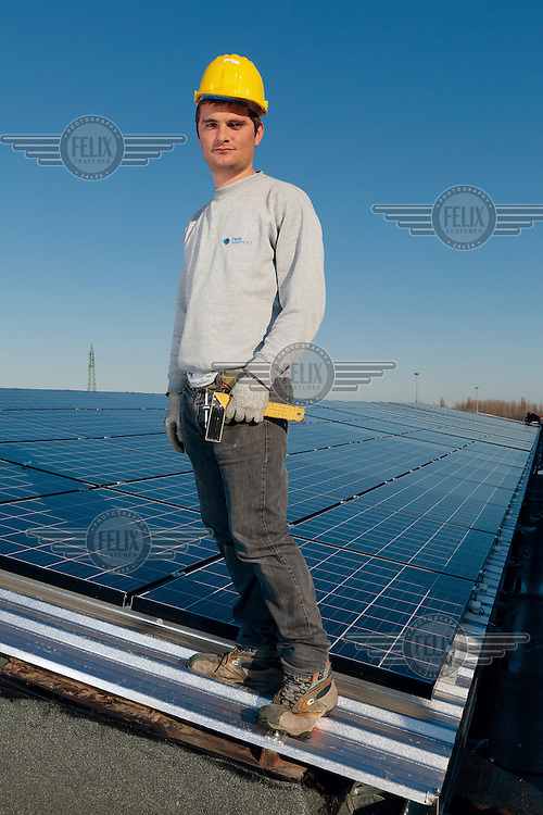 An Albanian migrant who lives in the small town of Faenza and works installing solar energy panels.