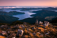 Endeavour Inlet in Marlborough Sounds after sunset with North Island visible in top left corner on horizon, Marlborough, New Zealand, NZ