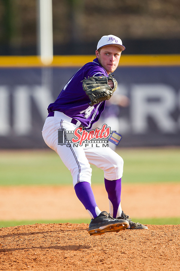 High Point Panthers relief pitcher Jeremy Johnson (14) in action against the Coastal Carolina Chanticleers at Willard Stadium on March 15, 2014 in High Point, North Carolina.  The Chanticleers defeated the Panthers 1-0 in the first game of a double-header.  (Brian Westerholt/Sports On Film)