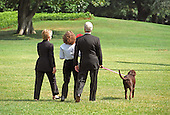 """Buddy"" the dog leads the First Family to Marine 1 on the South Lawn of the White House on August 19, 1999.  The Clintons are to vacation for 2 weeks in Martha's Vineyard.  From left to right: First lady Hillary Rodham Clinton, Chelsea Clinton, United States President Bill Clinton, ""Buddy"" the dog. On Tuesday, August 17, 1999, the President testified before the Grand Jury on his involvement in the Monica Lewinsky scandal and subsequently made a nationally televised statement admitting he had an inappropriate relationship with Ms. Lewinsky.<br /> Credit: Ron Sachs / CNP"