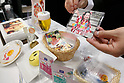 An exhibitor shows edible paper products during the 42nd International Food and Beverage Exhibition (FOODEX JAPAN 2017) in Makuhari Messe International Convention Complex on March 8, 2017, Chiba, Japan. About 3,282 companies from 77 nations are participating in the Asia's largest food and beverage trade show. This year organizers expect 77,000 visitors for the four-day event, which runs until March 10. (Photo by Rodrigo Reyes Marin/AFLO)